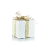 Gift box with golden ribbon  on white background Royalty Free Stock Photography