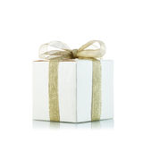 Gift box with golden ribbon  on white background Stock Photos