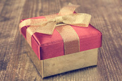 Gift box with golden ribbon. Stock Images