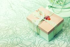 Gift box with green bow on abstract background Royalty Free Stock Photo