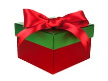 Gift box with green lid and red bow over white Stock Photos