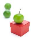Gift box and green plum Stock Photo