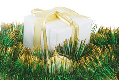 Gift box with green shiny garland Stock Photography