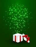 Gift box on green starry background Stock Images