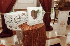 Gift box and guest book, wedding arch and aisle, decorated place. For wedding ceremony and reception royalty free stock photo