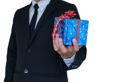 Gift box in hand. Businessman holding blue gift box in hand on white background with clipping path Stock Photos
