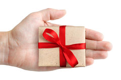Gift box in hand. Isolated on white background Royalty Free Stock Image