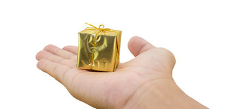 Gift box on hand. Isolated on white background, clipping path Royalty Free Stock Images