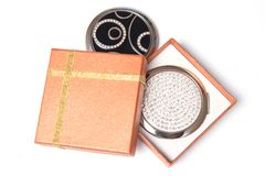 Gift box and hand mirrors Stock Photos