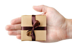 Gift box in hand top view. Isolated on white background Stock Images