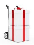 Gift box hand truck. Christmas gift box red ribbon hand truck Stock Image
