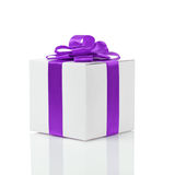 Gift box with handmade purple ribbon bow Stock Images