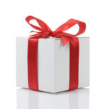 Gift box with handmade red ribbon bow Royalty Free Stock Photos