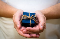 Gift box in  hands Stock Image