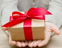 Gift box in the hands Stock Images