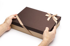 Gift box in hands on a white background. Cardboard box for gift packing Royalty Free Stock Photos