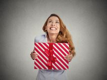 Gift box in hands of young happy woman Stock Photos