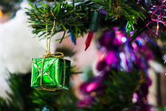 Gift box hang on chirstmas tree. Close up of christmas tree ornaments Stock Images