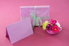 Gift box with happy mother day tag and blank card against pink background Royalty Free Stock Photo