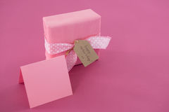 Gift box with happy mother day tag and blank card against pink background Royalty Free Stock Photography