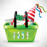 Gift box and hat in shopping basket Royalty Free Stock Photo