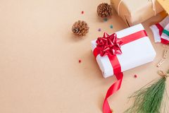 Gift box have bind from red ribbon with decoration items of Christmas day Stock Image