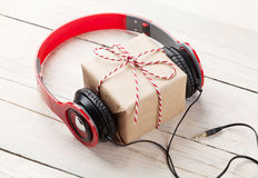 Gift box with headphones Royalty Free Stock Image