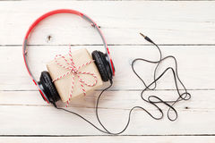 Gift box with headphones Royalty Free Stock Images