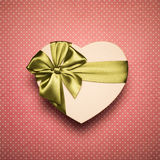 Gift Box Heart With Green Bow On Red Background. Royalty Free Stock Photo