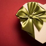 Gift Box Heart With Green Bow On Red Background. Royalty Free Stock Images