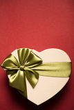Gift Box Heart With Green Bow On Red Background. Stock Photos