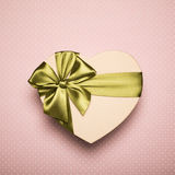 Gift Box Heart With Green Bow On Rose Background. Royalty Free Stock Images