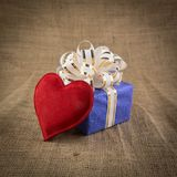 Gift box and heart on old  background Royalty Free Stock Photo