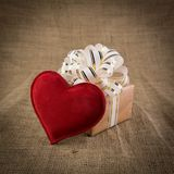 Gift box and heart on old  background Stock Photography