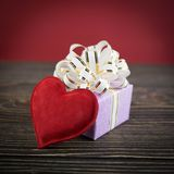 Gift box and heart on old  background Stock Image