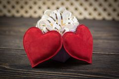 Gift box and heart on old  background Royalty Free Stock Image