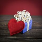 Gift box and heart Stock Photography