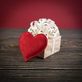 Gift box and heart on old wooden background Stock Photo