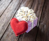 Gift box and heart. On old wooden background Stock Photos