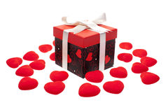 Gift box with heart ornaments Stock Images