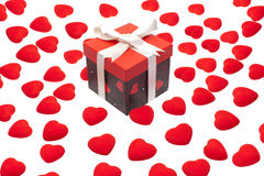 Gift box with heart ornaments Stock Photos