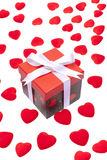 Gift box with heart ornaments Royalty Free Stock Photo