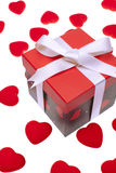 Gift box with heart ornaments Royalty Free Stock Photos