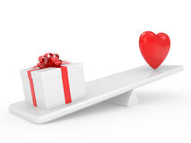 Gift box with heart on scales Royalty Free Stock Image