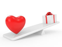 Gift box with heart on scales Royalty Free Stock Images