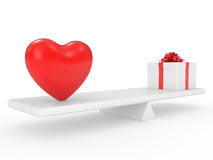 Gift box with heart on scales Stock Photos