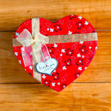 Gift box with heart shape with inscription i love you on wooden background Stock Image