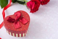 Gift box with heart shape Stock Photos
