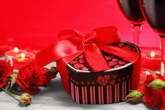 Gift Box Heart Shape with Wine and Roses Stock Photo