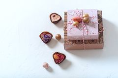 Gift box, heart-shaped candy. The Concept Of Valentine`s Day. On a white concrete background. Selective focus stock images